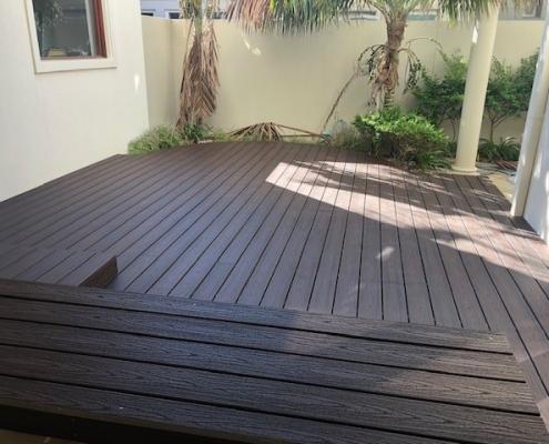 Dark wooden deck in The Shire
