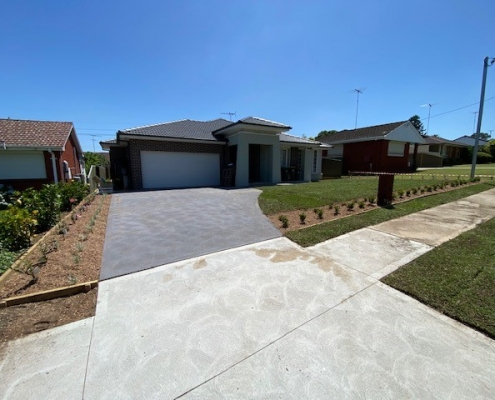 New Concrete driveway, lawn and garden beds in Greystanes