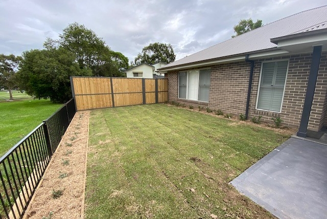 New timber fence, turf, garden beds and plants in Kings Langley