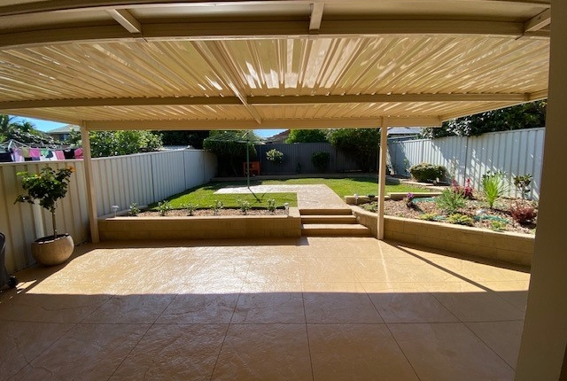 Outdoor patio with concrete pavers in the Hills District
