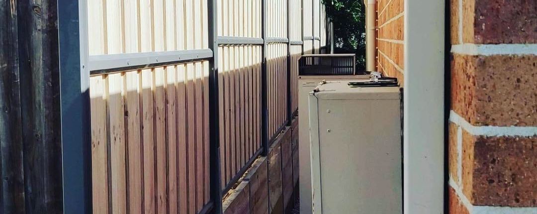 Wooden fence and retaining wall in Kellyville