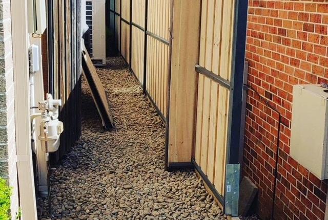Wooden fence and gravel side path in Kellyville